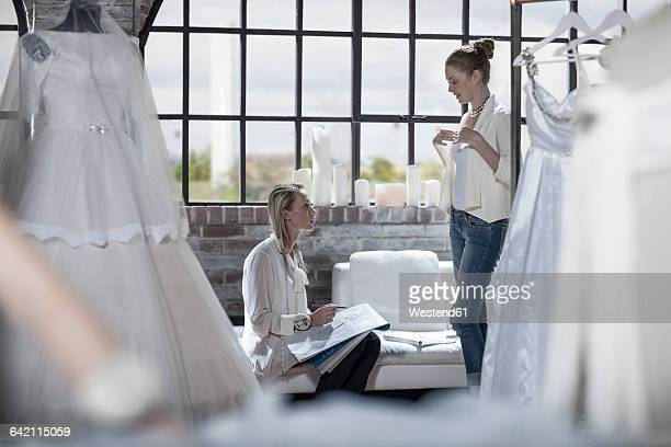 Wedding dress designer and bride to be