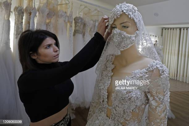 Wedding dress designer Lobna Safadi from the Druze village of Majdal Shams in the Israelannexed Golan Heights attaches a matching embroidered...