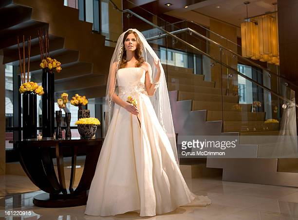 Wedding dress fashion on Thursday, March 24, 2011 from the Four Seasons Hotel in Denver with model Carli from Donna Baldwin. Sassi Holford organza...