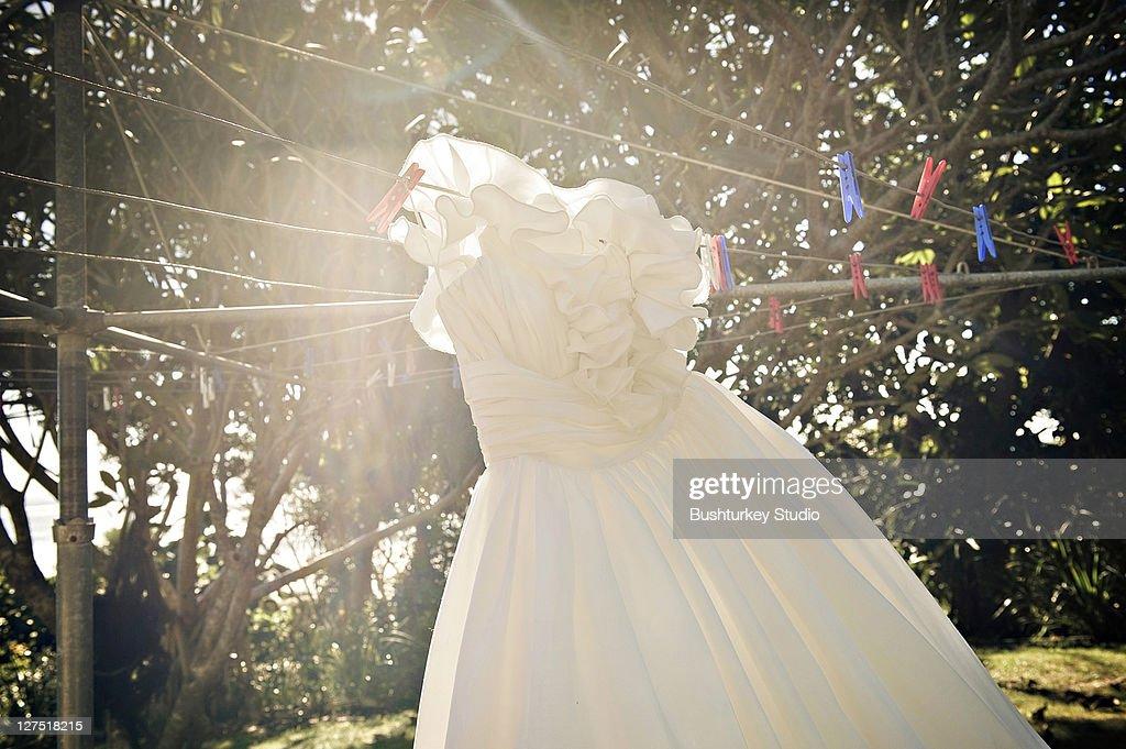 Wedding Dress Hanging On Hills Hoist Clothes Line Stock Photo