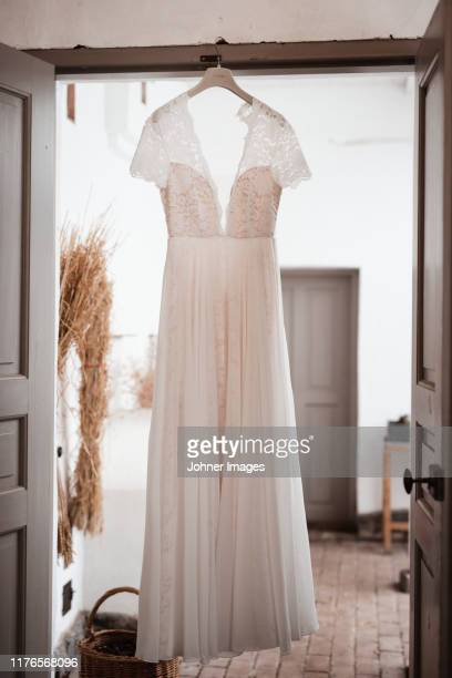 wedding dress hanging - wedding dress stock pictures, royalty-free photos & images