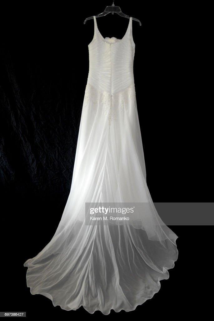 Wedding Dress Hanging W Black Background Stock Photo