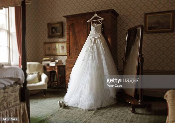 wedding dress in hotel room
