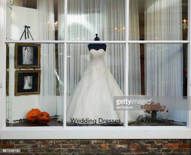 Wedding dress is displayed alongside Pumpkins in a bridal shop during the Whitby Goth Weekend on October 27, 2017 in Whitby, England. The Whitby Goth...