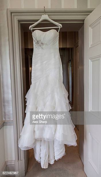wedding dress waiting to be worn - wedding dress stock pictures, royalty-free photos & images