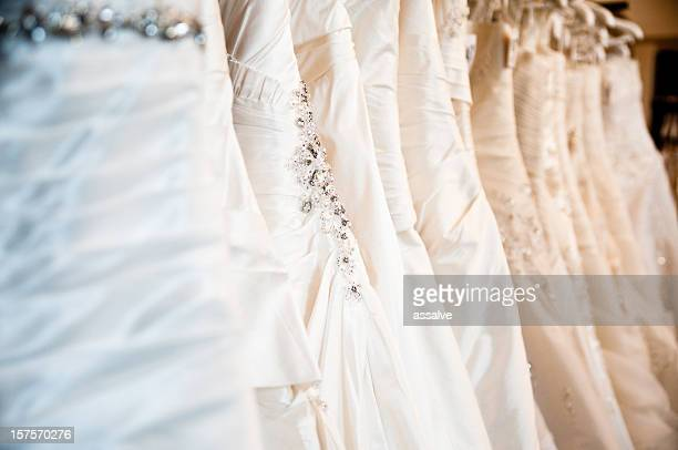 wedding dresses in a bridal store - wedding dress stock pictures, royalty-free photos & images