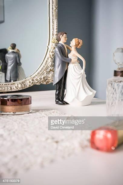 Wedding figurines on dressing table