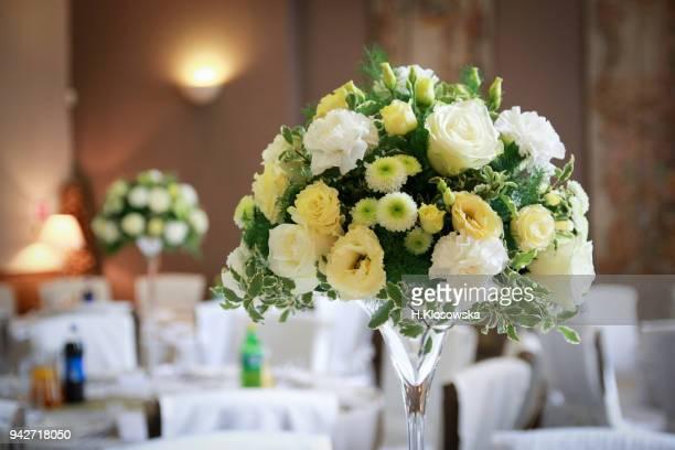 wedding flower arrangement on the table - ブーケ ストックフォトと画像