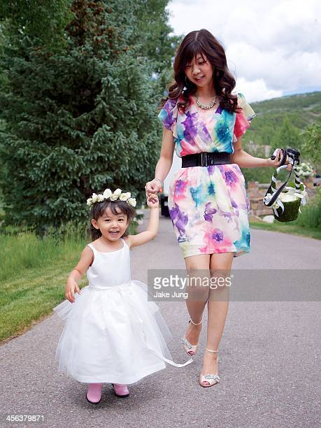 Wedding flower girl holding hands with her mom