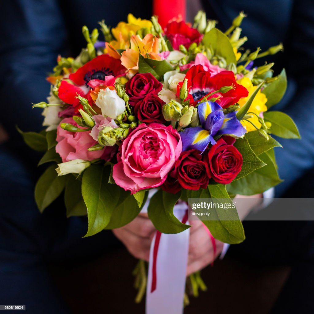 Wedding Flowers Groom Holds Bouquet Of White Blue Yellow Flowers And