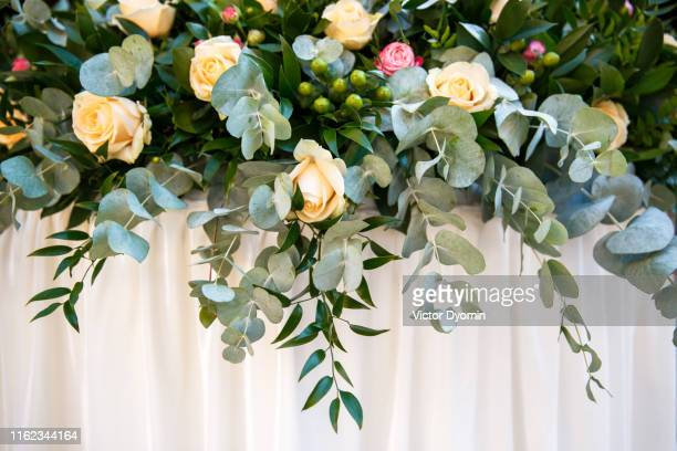 wedding flowers on a background of wedding table - wedding background stock pictures, royalty-free photos & images