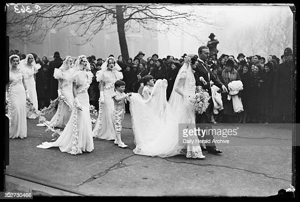 Wedding group 1933 A photograph of a bride groom pageboys and bridesmaids outside St Margaret's Church in Westminster London taken by James Jarche...