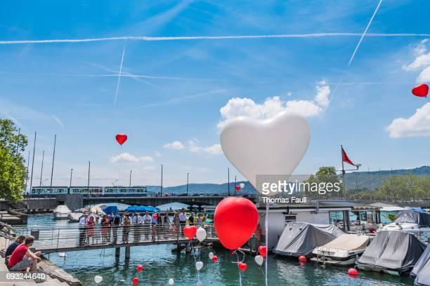 Wedding group release balloons in Zurich