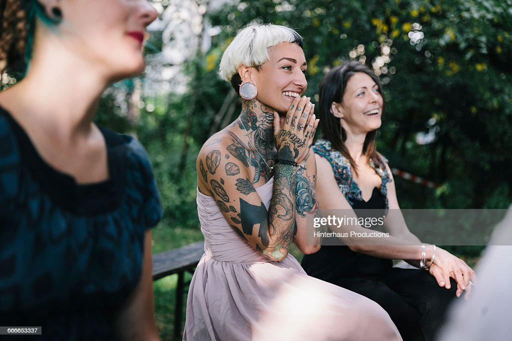 Wedding guest looks on as friends get married : Stock Photo