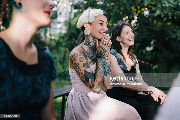 wedding guest looks on as friends get married - leanincollection stock pictures, royalty-free photos & images