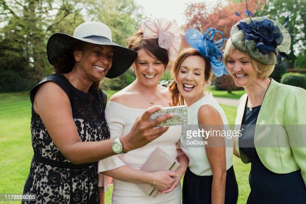 wedding guest selfie - fascinator stock pictures, royalty-free photos & images