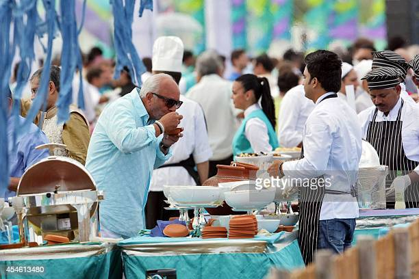 Wedding guests enjoy a buffet at a beach close to the tiny village of Savelletri di Fasano on September 4 2014 where they are attending the wedding...