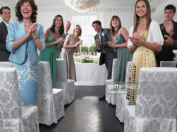 wedding guests looking down aisle - wedding guest stock pictures, royalty-free photos & images