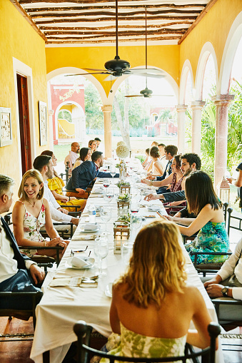 Wedding guests seated at table for dinner during outdoor wedding reception - gettyimageskorea