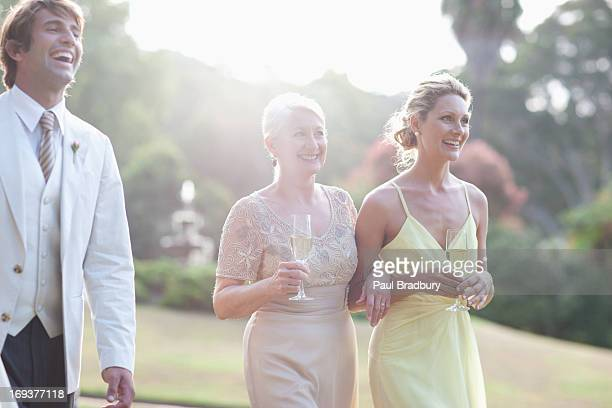 Wedding guests walking across lawn