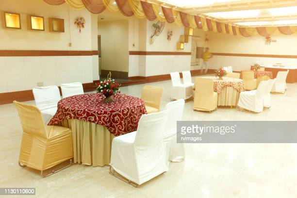 wedding hall or other function facility set for fine dining, round table - banquet hall stock pictures, royalty-free photos & images