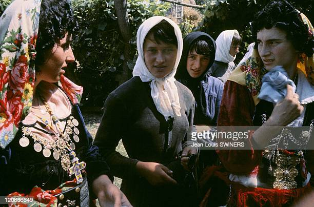Wedding in Albania in November 1964 The young girl wearing a white scarf getting ready to dance in a wedding
