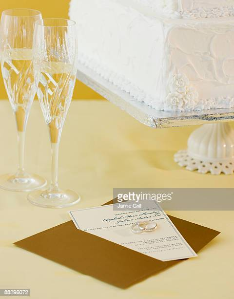 Wedding invitation and cake