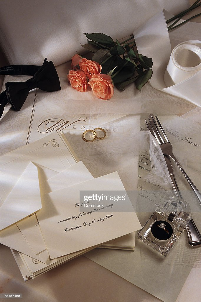 Wedding invitations and flowers with rings : Stock Photo