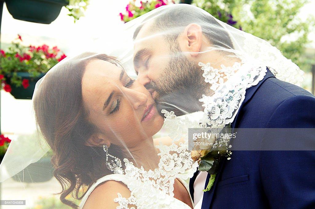 Wedding kiss bride and groom kissing stock photo getty images wedding kiss bride and groom kissing stock photo junglespirit Choice Image