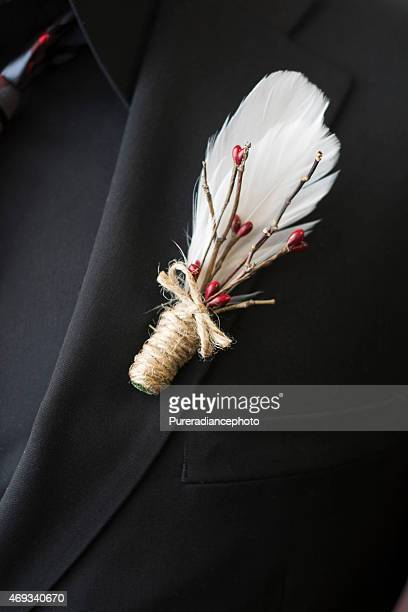 Wedding lapel made of feathers and winter berry