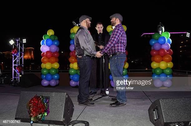 Wedding officiant Greg Chase marries Jes Cumpian and Halley Clark both of Nevada at Las Vegas PRIDE's National Coming Out Day festival at the Alexis...