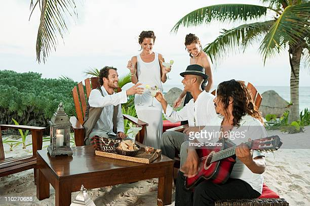 Wedding party and man playing guitar