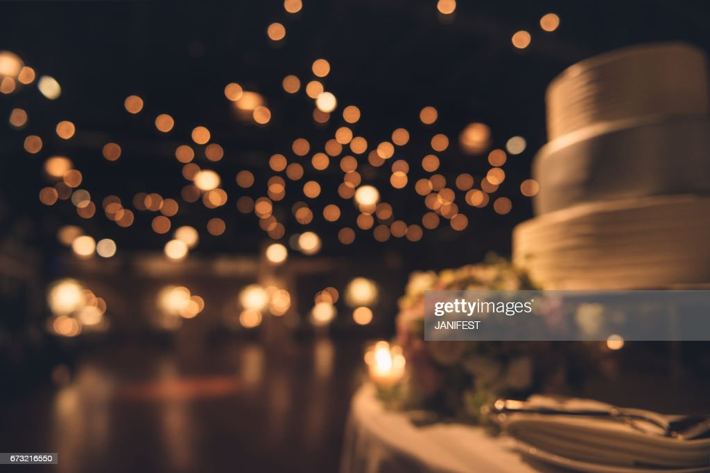 Wedding party evening. Blurred dance floor and wedding cake : Stock Photo