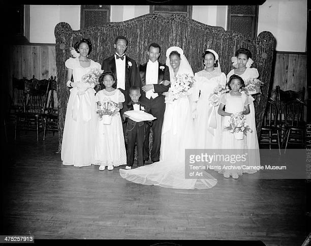 Wedding party including John Martin groom Isaiah Jones Jr bridesmaids Eleanor and Mildred Barbour bride Betty Barbour Jones flower girls Patricia and...