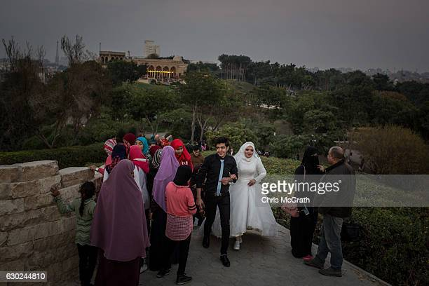 A wedding party is seen in Cairo's famous AlAzhar Park on December 10 2016 in Cairo Egypt Since the 2011 Arab Spring Egyptians have been facing a...