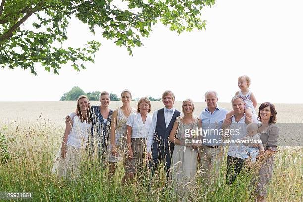 Wedding party smiling in wheatfield