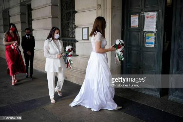 Wedding party wait outside Nottingham City Hall for their marriage ceremony ahead of Tier Three restrictions on October 28, 2020 in Nottingham,...