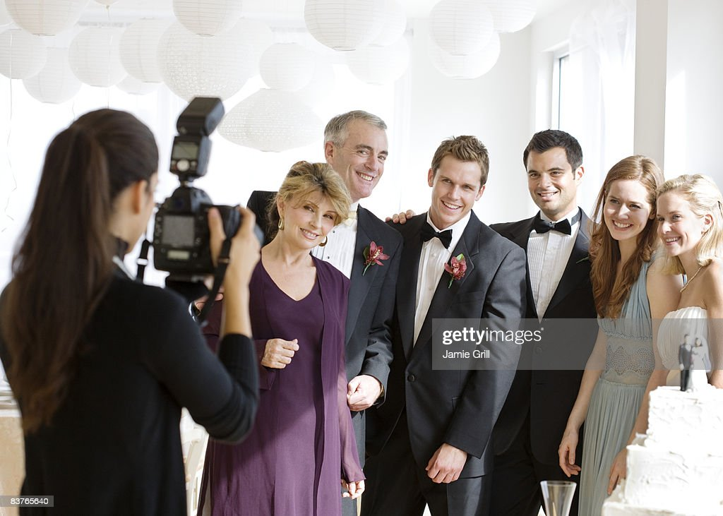 Wedding Photographer Taking Picture Of Party Stock Photo