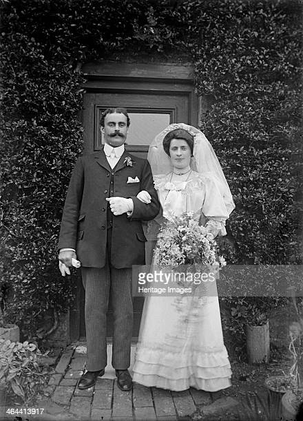 Wedding portrait Hellidon Northamptonshire c1896c1920 A bride and groom pose outside the door of an unidentified house with the bride holding a...