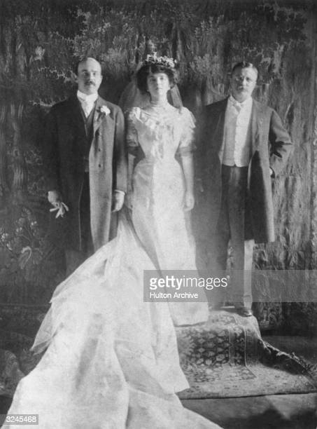 Wedding portrait of Nicholas Longworth and Alice Roosevelt posing with the bride's father US president Theodore Roosevelt The bride is wearing a...