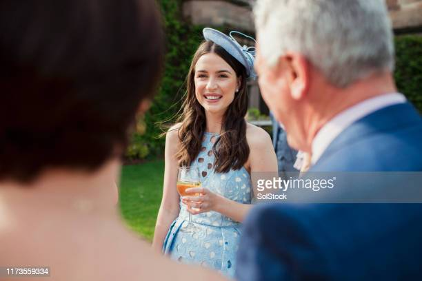 wedding reception guest - fascinator stock pictures, royalty-free photos & images