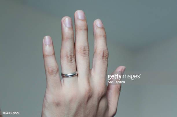 wedding ring of a young man worn on the ring finger - white gold stock pictures, royalty-free photos & images