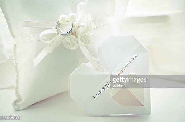 wedding ring pillow and origami invitation - white gold stock pictures, royalty-free photos & images
