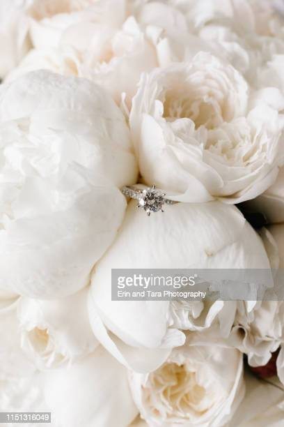 wedding ring submerged in flowers - wedding background stock pictures, royalty-free photos & images
