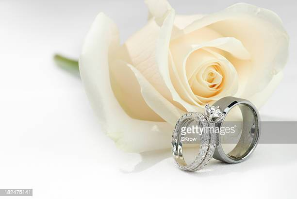Wedding Rings and a White Rose