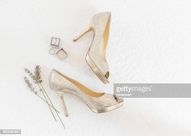 wedding rings and shoes with lavender flowers - stiletto stock pictures, royalty-free photos & images