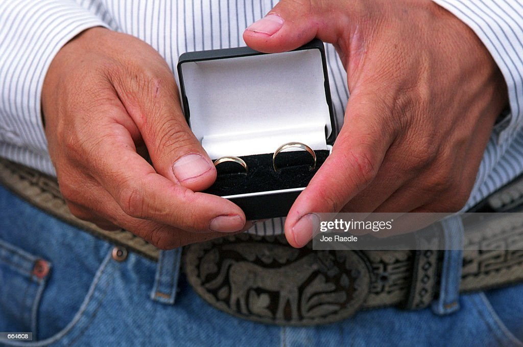 Wedding rings are presented during a wedding ceremony inside a prison October 2, 2000 at Ciudad Juarez, Mexico. Mexican law allows for inmates to marry inside prison walls. 5 couples, one current inmate and four former inmates were married by their church pastor. (Photo by Joe Raedle/Newsmakers) TO