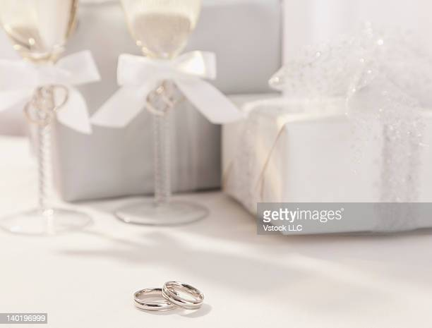 Wedding rings, champagne flutes and wedding presents