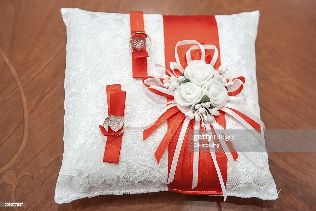 Wedding rings lie on the pillow. : Stock Photo