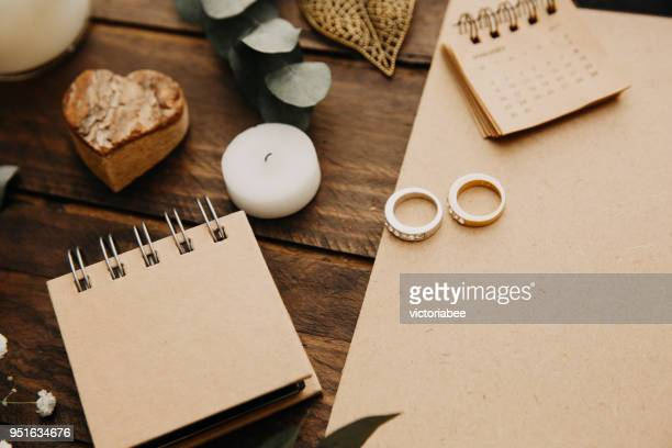 Wedding rings, notepad and calendar